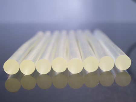 Glue sticks on black backgrond with reflection