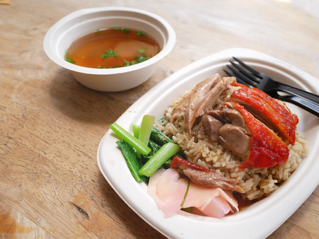 roasted duck over stream rice with soup on bagasse dish for take away Standard-Bild - 114839805