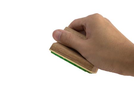 Sello de goma de madera cuadrado de agarre de mano aislado sobre fondo blanco Foto de archivo