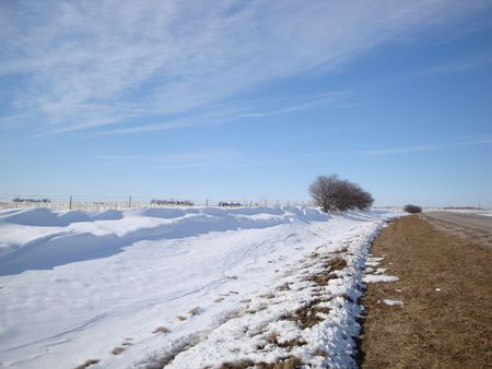 country highway: Snow drifts along a deserted country highway