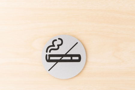 allow: no smoking allow sign on the wood wall