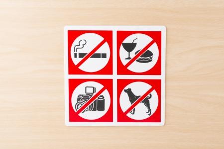 no smoking, no food, no camera, no dog sign on the wood wall photo