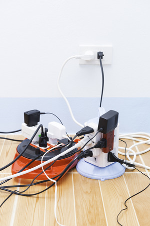 too many electronic plugs on the outlet Stock Photo
