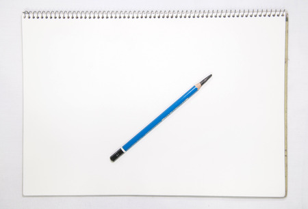 White Note Book and pencil photo