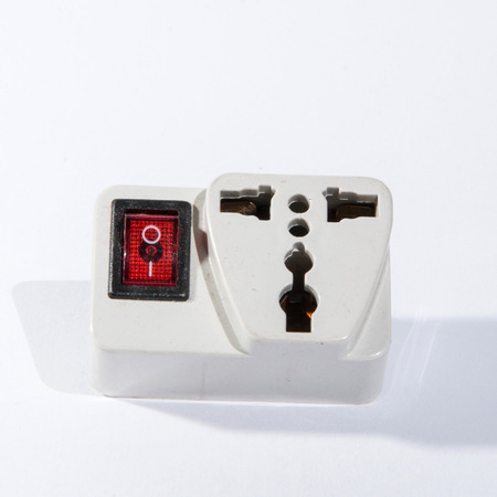 life extension: Red lighting outlet switch Stock Photo