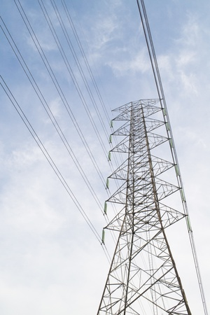 high voltage tower on blue sky