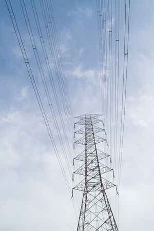 high voltage tower on blue sky photo