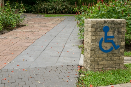 disable sign on walkway in the park photo
