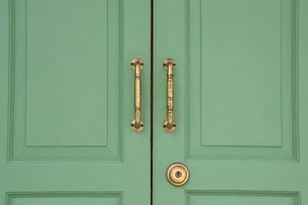 Green wood door with bronze handle photo