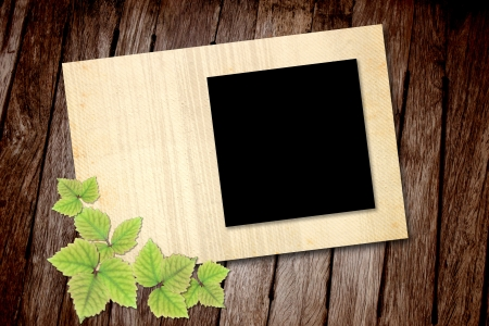 Blank picture frame on old wooden texture photo