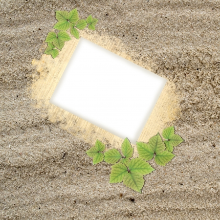 Blank picture frame in sand texture photo