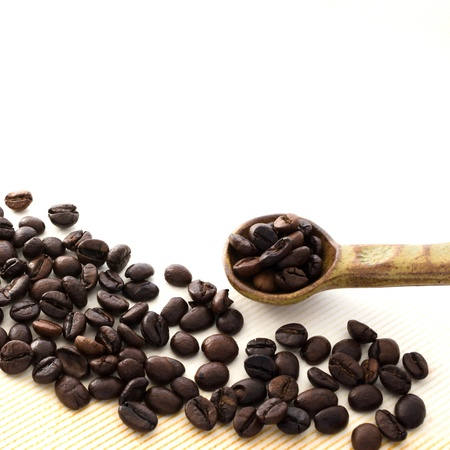 coffee bean and spoon isolated on white Stock Photo - 16531034