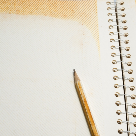 Blank old note paper and pencil photo