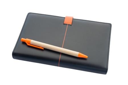 Zwart lederen notebook en pen ge Stockfoto
