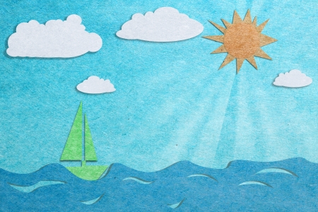sun and blue sea recycled paper craft background photo