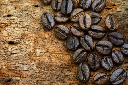 coffee bean on grunge wooden background photo