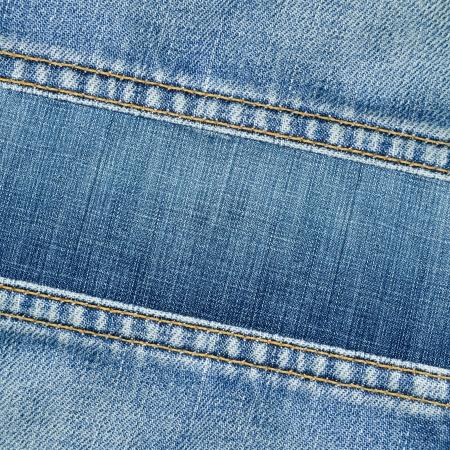 Worn blue denim jeans texture, background 版權商用圖片