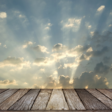 sun ray and wooden terrace photo