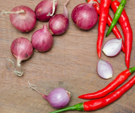 red onion and chili on wooden table photo
