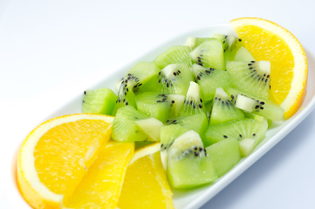 kiwi fruit and orange slice on white background photo
