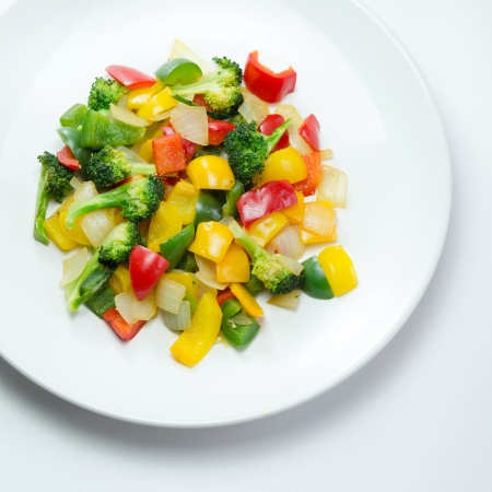 stir fried vegetables in white dish