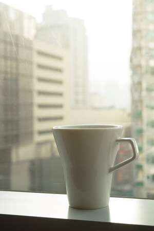 a cup of coffe with city view Standard-Bild