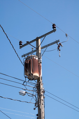 tangling: Old transformers of an electrical post with power-lines