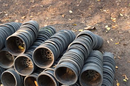 empty black gardening buckets on the ground
