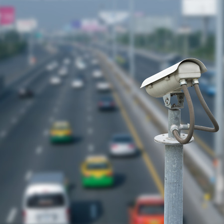 CCTV camera with blur traffic road background