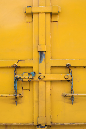 door lock love: yellow old metal door