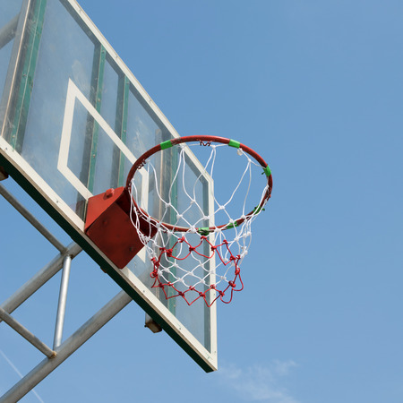 swish: basketball hoop against blue sky background