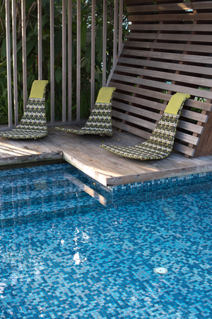 conner: chair near swimming pool Stock Photo