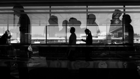 Silhouette of double exposure shot, people busy in the airport Stock Photo