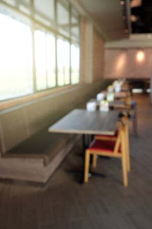 table and chairs in coffee shop blur background