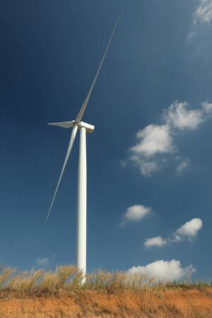 Modern Windmill Turbine with blue sky and clouds, Wind Power, Green Energy