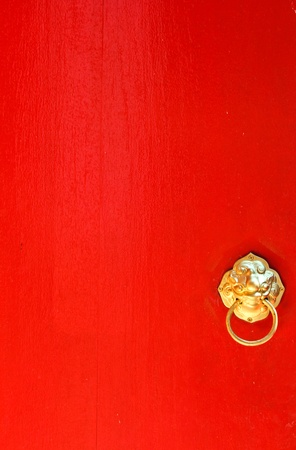 Red door with golden knocker  photo