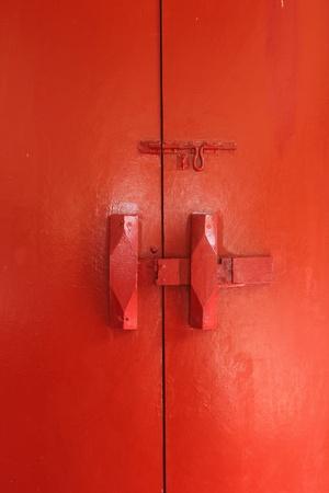 Red lock on the red door  Stock Photo