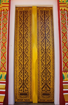 Traditional Thai style gold painting art on the thai temple door photo