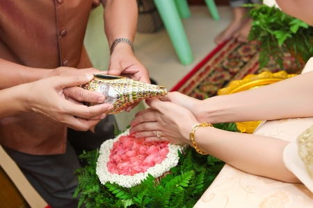 Blessed water at Thai wedding ceremony in Thailand Stock Photo