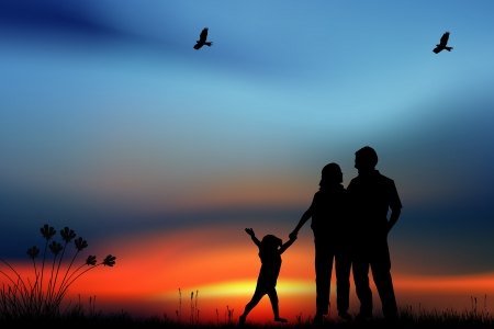 happiness people silhouette on the sunset: Family on the meadow
