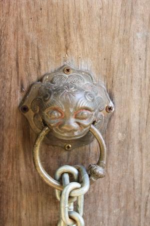 ancient wooden door with knocker photo