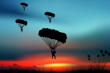 Parashutist on the sky photo