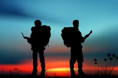 Silhouette of two men of backpacker tourists photo