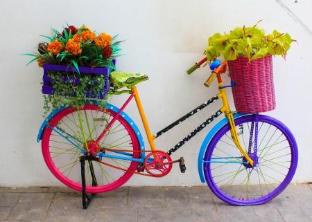 steel bike and flower pots in the garden