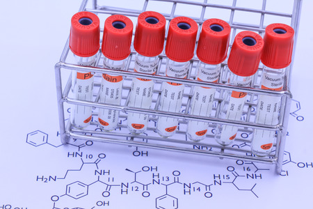 anticoagulant: Blood tube with chemical structure for testing in laboratory