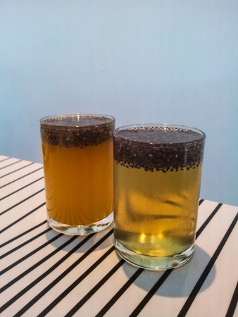Full glass of orange juice with chia seed Stock Photo