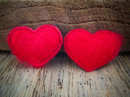 Two heart on wood background with vintage color