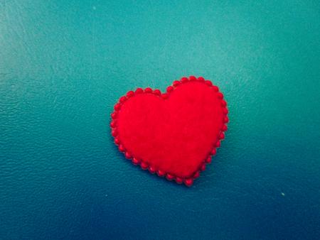 Red heart on background, vintage color