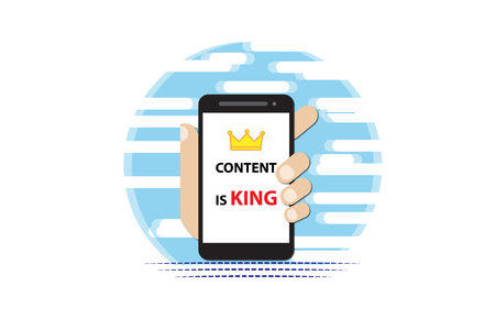 The hand holds the phone with content is king letters on the blue background