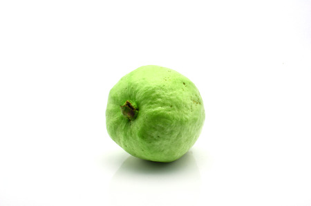 Single organic guava fruit on white background photo